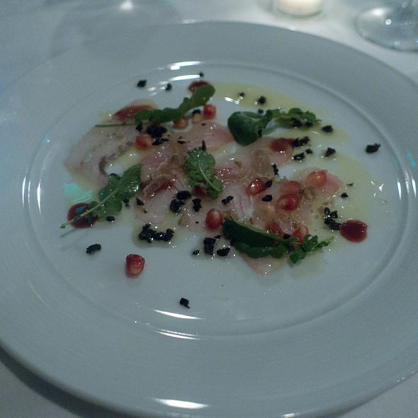 local halibut, black olive, pomegranate, watercress, white truffle