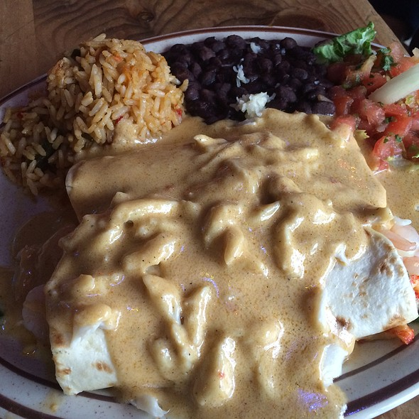 Gulf Coast Seafood Enchiladas Stuffed With Sautéed Shrimp, Crawfish And Melted Poblano Jack Cheese Covered With A Cajun Spiced Three Cheese And Lump Crabmeat Sauce @ Border Cafe