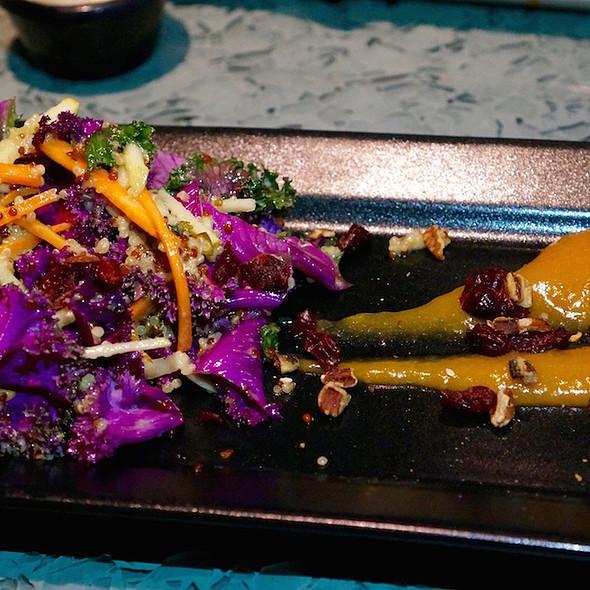 Kale-quinoa salad, dried fruit, amaretto peach coulis, lemon vinaigrette