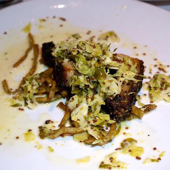 Pork belly pastrami, rye spaetzle, Brussels sprouts sauerkraut, mustard jus