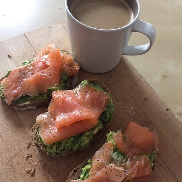 Avocado With Smoked Salmon On Toast With White Coffee @ Home