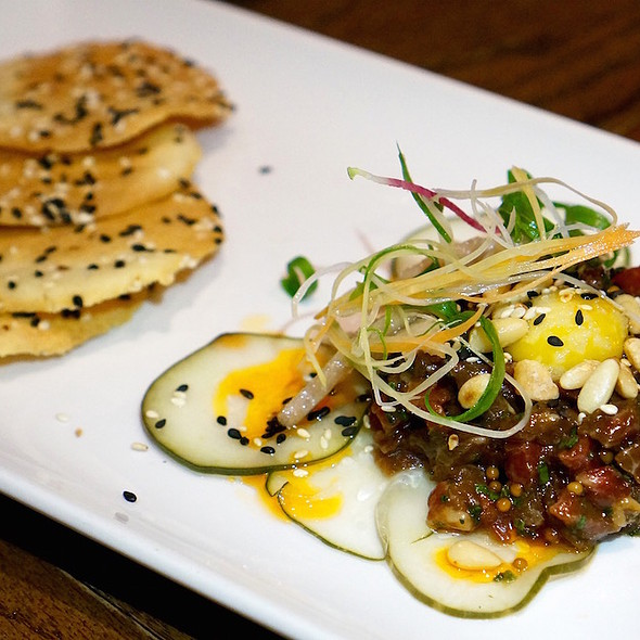Strube Ranch wagyu tartare, sesame, kirby cucumbers, pickled Asian pear, quail egg, rice crackers