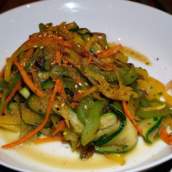 Soy glazed vegetables, zucchini ribbons, julienned carrots, peppers, garlic, sugar snap peas