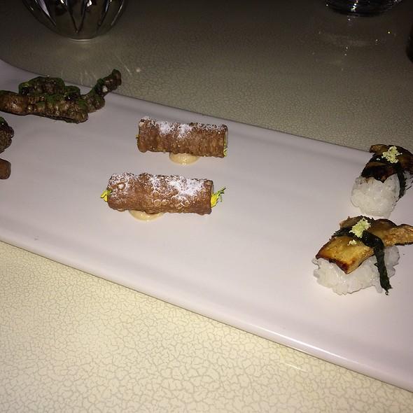 Nigiri, Matsutake, Nori, Wasabi - Cannoli, Salmon Mousse, Caraway, Mustard Flowers - Morcilla Chip, Chimichiri. Rasin, Orange