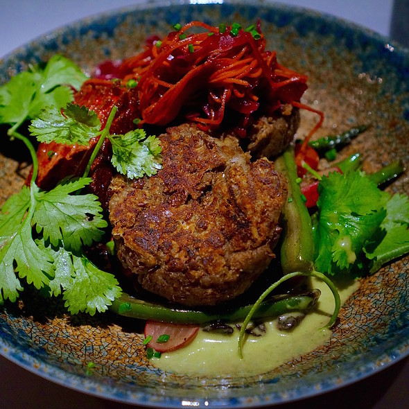 Garam masala lentil cakes, ginger, beet misozuki marinated tofu, vegetables, kimchi, herbs, green curry