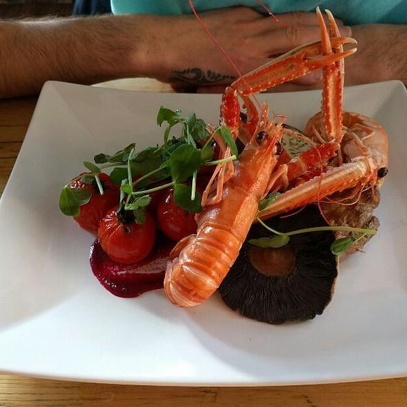 Ribeye Steak, Langustines, Vine Roast Tomatoes, Beetroot Puree, Portobello Mushroom, Sweet Pea Shoots With Cafe De Paris Butter