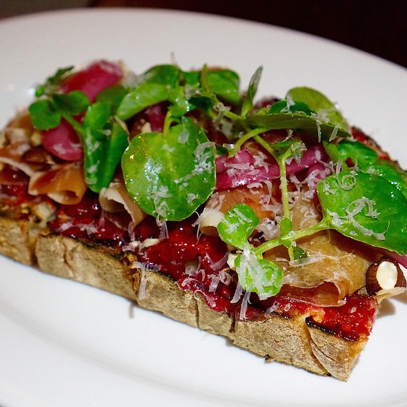 Prosciutto bruschetta, citrus-raspberry jam, pecorino, pickled onion, hazelnuts, watercress
