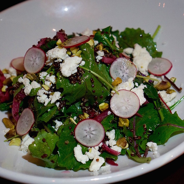 Kale salad, feta cheese, pickled onion, pistachios, red quinoa, poppy seed vinaigrette