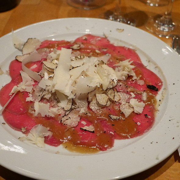 Beef Carpaccio, Poached Egg, Truffle, Parmesan Cheese