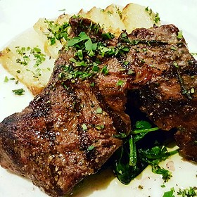 Grilled Flatiron Steak with Scalloped Potatoes, Braised Winter Greens and Garlic Rosemary Oil