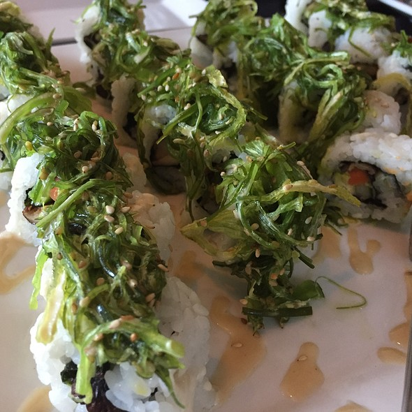 Veggie Roll With Avocado And Carrot, Topped With Seaweed Salad