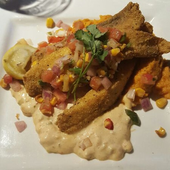Crispy Talapia With A Sweet And Spicy Sauce Over A Bed Of Veggies - Lottinville's Restaurant and Bar, Edmond, OK