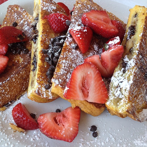 Banana Chocolate Chip Stuffed French Toast With Strawberries On Top