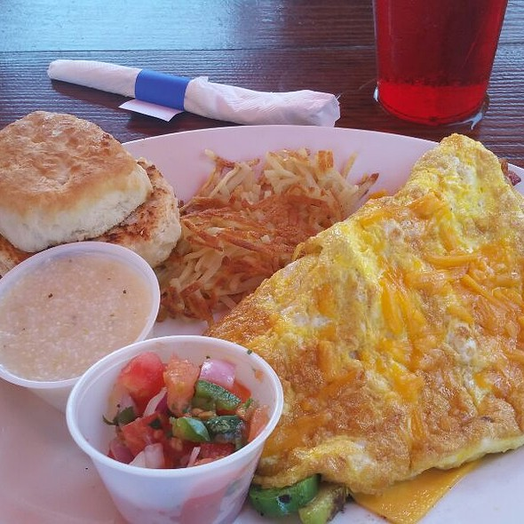 Caldara Jalapeno, Green Pepper. Onion, Avocado,  Sour Cream, Salsa Omlette With Hash Browns, Grits And Fluffy Biscuit  @ Coconuts Restaurant