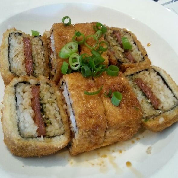 FRIED Spam Musubi Yes, Spam!  Hawaiians know the secret.  A grilled slice of teriyaki coated Spam wrapped with rice and nori  @ Da Kitchen