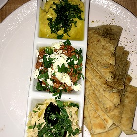 Mezze w. Baba Ghanoush, Potato Haro (Spicy Potato), Fatayer Spinach, Fatoush Salad, Hummus, Falafel and more, served w. pickles olives, tahina sauce & Lebanese bread