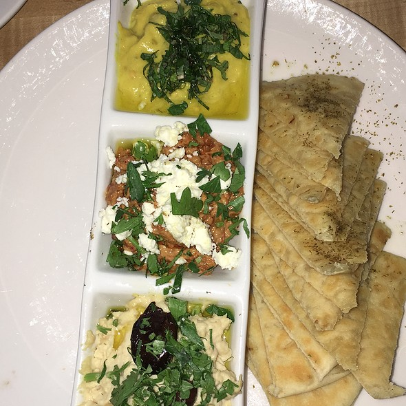Mezze w. Baba Ghanoush, Potato Haro (Spicy Potato), Fatayer Spinach, Fatoush Salad, Hummus, Falafel and more, served w. pickles olives, tahina sauce & Lebanese bread - Rezaz Mediterranean Cuisine, Asheville, NC