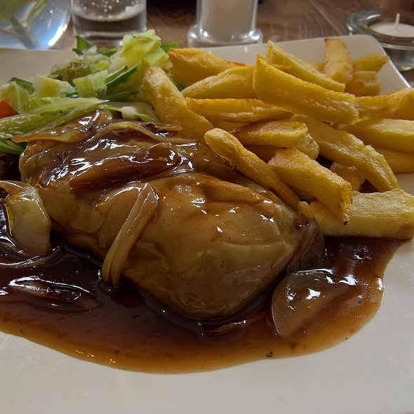 Rag Pudding with Chips Vegetables & Onion Gravy