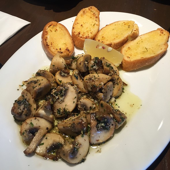 Sauteed Mushroom With Lemon Wedges In Bread @ Bow Wow Cafe