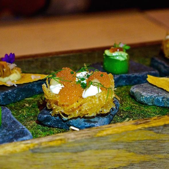 Canapés – cucumber with trout roe; crisp potato cake with sour cream and lemon confit; venison sourdough crisp