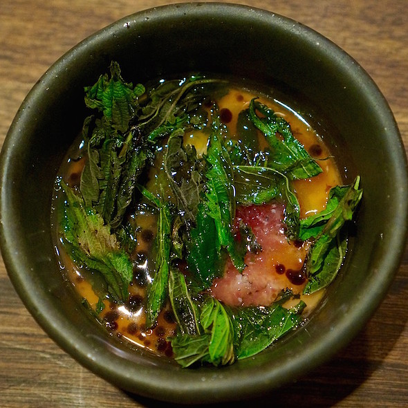 Baked egg, chanterelles, crisp wild nettles, grated radish, dashi @ Momofuku Ko