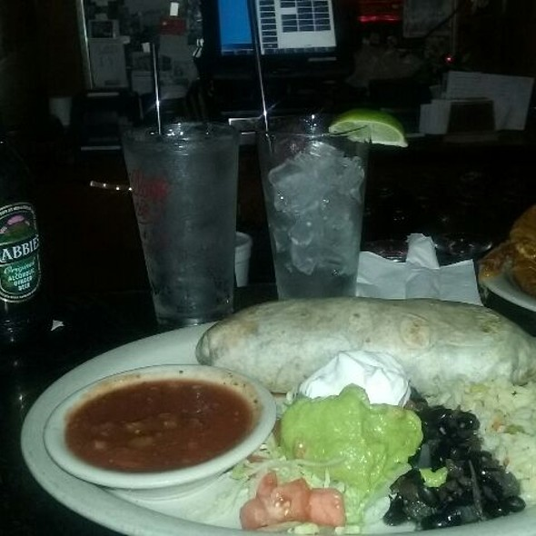 Beef & Cheese Burrito - loaded with beef and cheddar cheese with onion and peppers as well as with black beans, rice & cheddar cheese, served with lettuce, tomato, guacamole, sour cream and salsa @ The Village Cafe