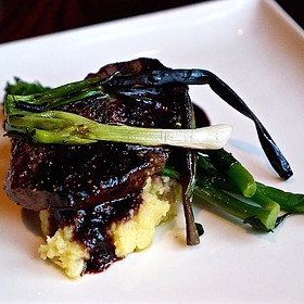 Mountain River elk loin, crused potato-leek confit, broccolini, grilled spring onions, huckleberry vincotto