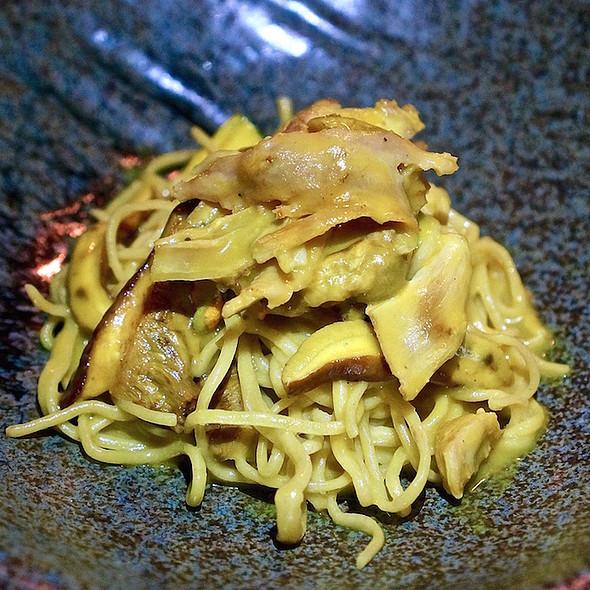 Egg yolk spaghetti, roasted rabbit, foraged bolete mushrooms, zucchini flowers, orange bell pepper sauce @ Heirloom
