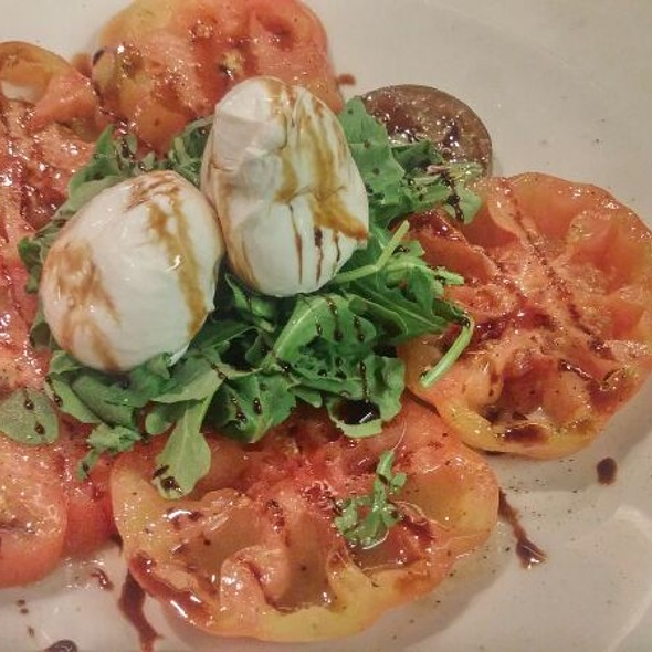 Burrata ~ Heirloom Tomato Carpaccio, Arugula, Castelvetrano Olives, Fresh Burrata.