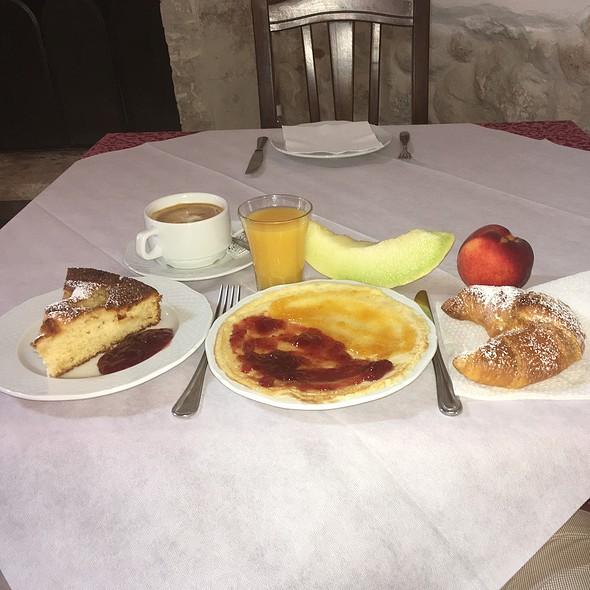 Pancake And Apple Pie With Jam, Melon/Nectarine, Warm Orange Flavoured Croissant Washed Down With Cappucino And Oj