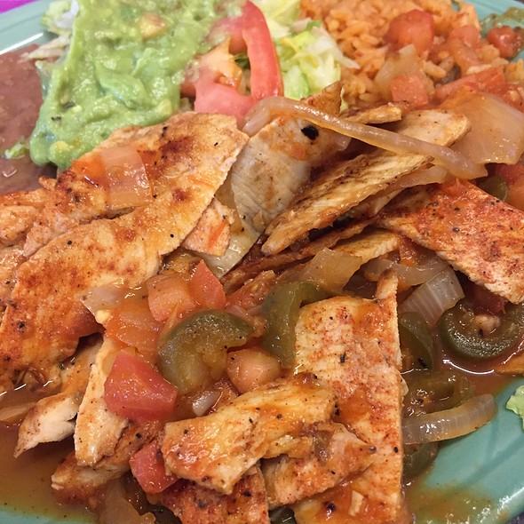 Chicken Ranchero: Chicken Fajitas With Rancheros Sauce, Rice, Beans, And Guacamole