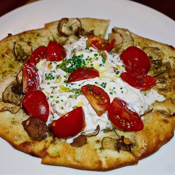 House-made stracciatella, tomatoes, mushrooms, truffles on housemade flatbread @ Ema