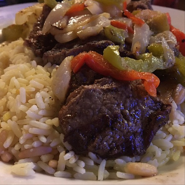 Sirloin Beef Tips With Peppers And Onions Over Rice Pilaf @ Chelo's Hometown Bar & Grill