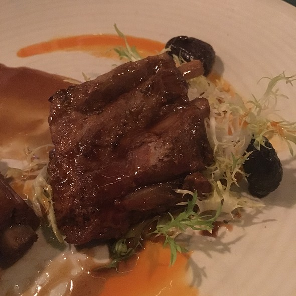 Wild Boar Spare Ribs with demi-glace, pickled cherries and frisee @ Wolfgang Puck Pizza   Bar