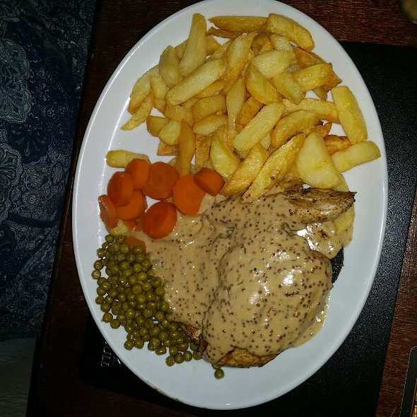 Chicken Breast With Black Pudding & Mustard Cream Sauce, Homemade Chips, Carrots & Peas