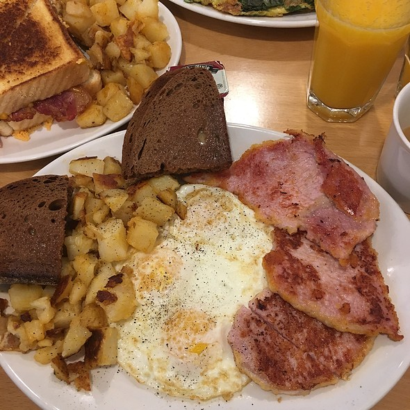Three Eggs With Peameal Bacon, Home Fried Potatoes And Dark Rye Toast