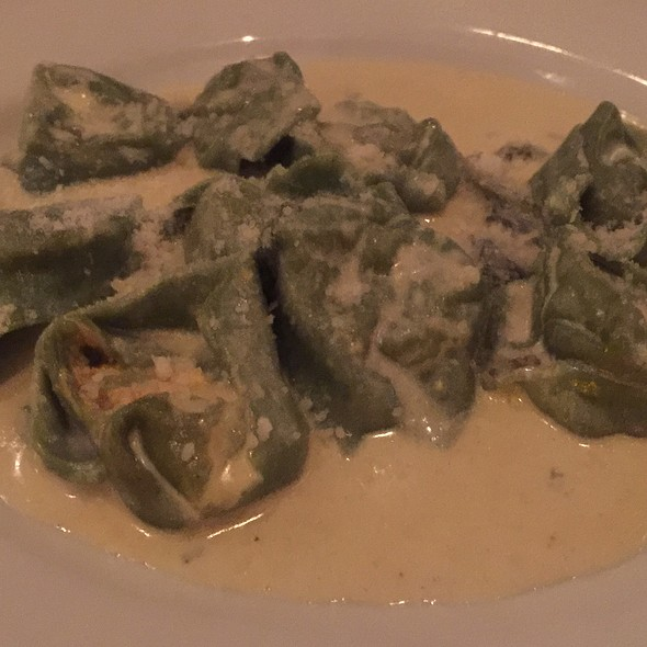Fresh Tortelloni Filled With Pumpkin And Ricotta, With Chestnut Mushroom, White Wine Cream Sauce, Drizzled With Truffle Oil @ Il Pastaio Restaurant