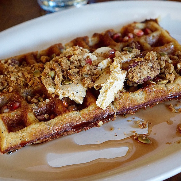 Sourdough pearl sugar waffles, roasted acorn squash butter, pomegranate maple syrup, pumpkin seed and pecan granola
