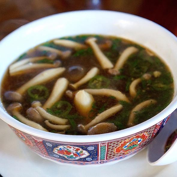 Spicy miso soup, tofu, scallion, beech mushroom, serrano, pickled kombu @ Milktooth