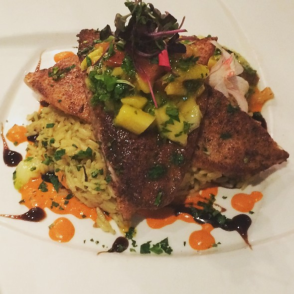 Pompano with mango salsa, over herbed rice