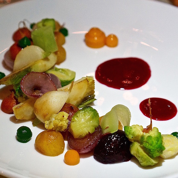 Warm organic vegetable salad, baby beets, carrots, onions, Brussels sprouts, romanesco, seabuckthorn, tarragon