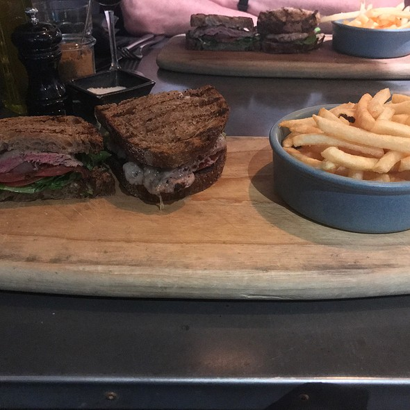 Steak Sandwich (With Grilled Eye Fillet, Manchego, Roasted Pears, Caramelised Onion, On Sourdough Rye And Fries)