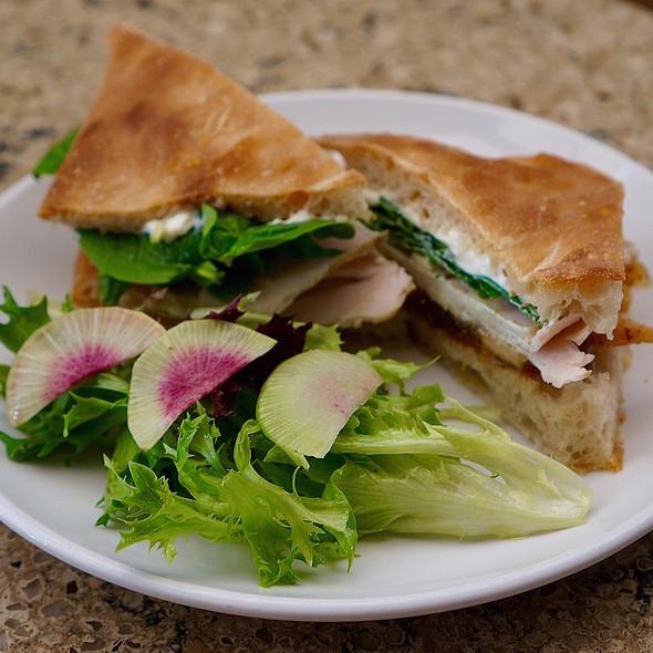 Turkey sandwich with apple mostarda, camembert, spinach on foccacia