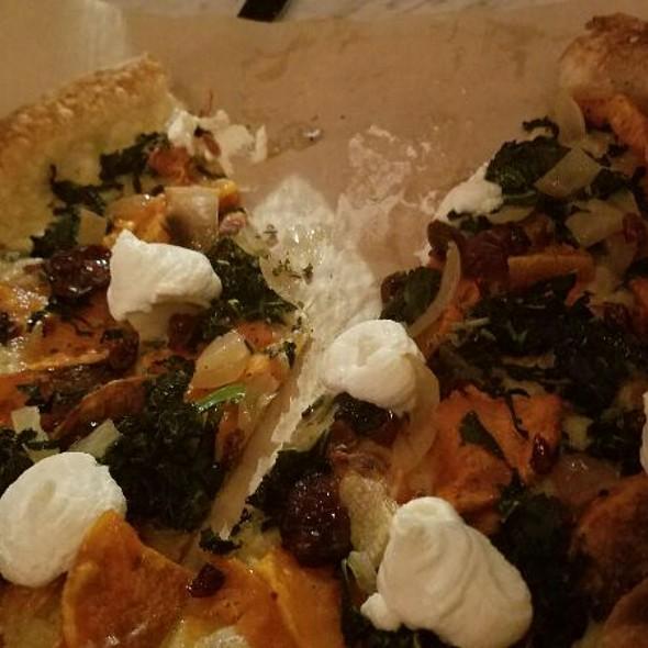 Butternut squash pizza – sage, gruyère, speck ham, arugula, butternut squash purée