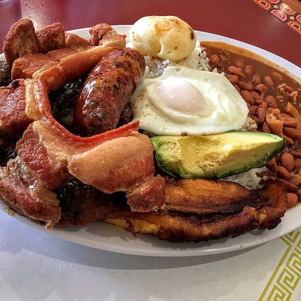 Bandeja Paisa: Carne Asada, Chicharron, white rice, egg, arepa, tostones/plantains, and beans. @ El Paisa