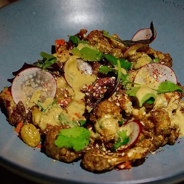 Cailflower korma, golden raisins, crispy shallots, pickled carrots