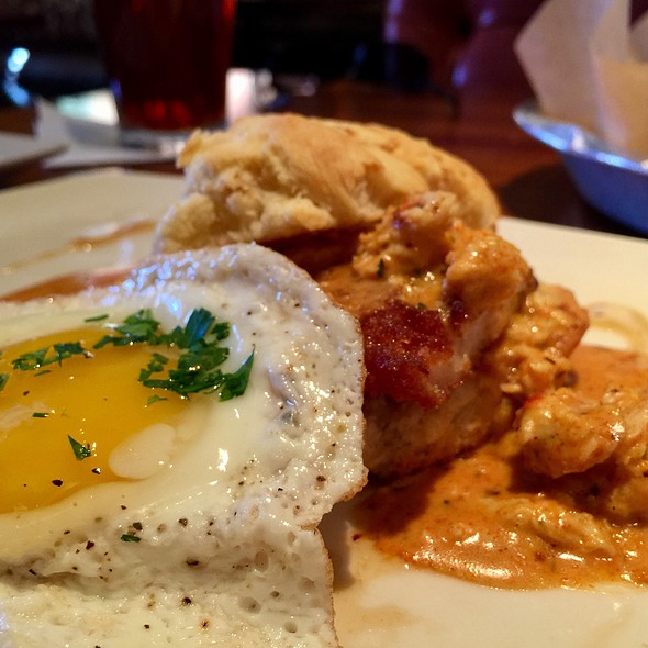 Country Style Fried Chicken With Eggs And Gravy Over Biscuits