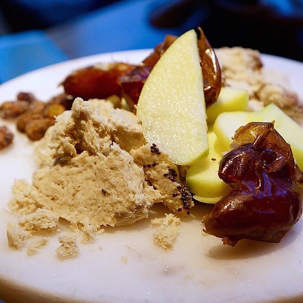 Halva, candied pistachios, dates, apple