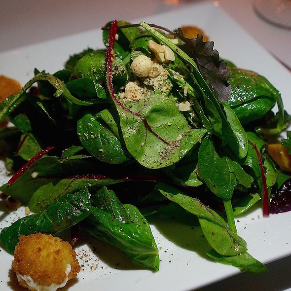 Mixed greens salad, roasted beets, toasted hazelnuts, goat cheese croutons, sherry vinaigrette
