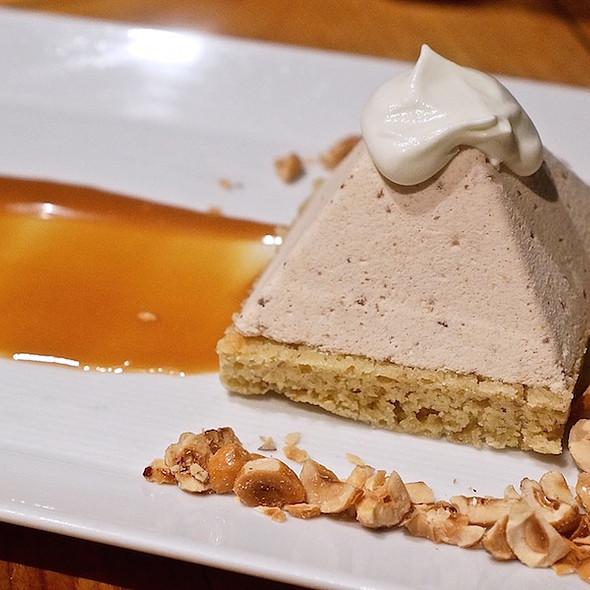 Hazelnut nougat glacé, praline, millet sponge cake, bourbon caramel